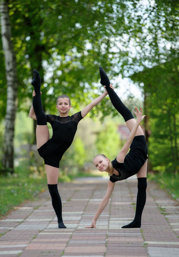 Artistic Athlete Balance Caucasian Caucasian Ethnicity Female Gymnast  Gymnastics Happiness Professional Rhythmic Split Sport Spring Stretch Two Vertical Women Young Women