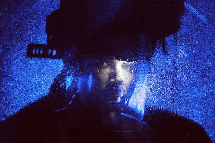 Close-up of man wearing helmet