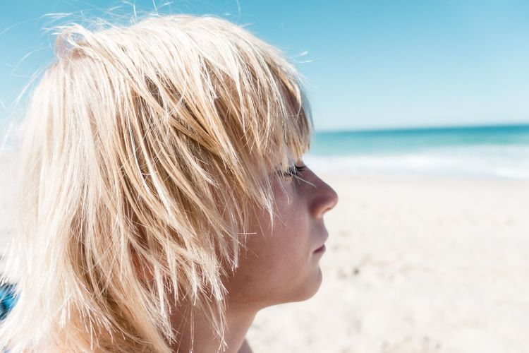 Boy... Portrait Beach Sea Land Headshot One Person Water Portrait Hair Blond Hair Lifestyles Nature Real People Focus On Foreground Close-up Hairstyle Horizon Over Water Outdoors Sand Sky A New Beginning
