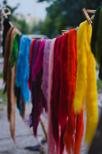 Hanging Clothing Textile No People Focus On Foreground Multi Colored Drying Choice Variation Red Day Close-up Coathanger In A Row Retail  Clothesline Outdoors Market Selective Focus For Sale