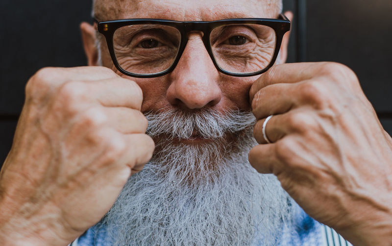 Close-up of senior hipster with white beard and mustache