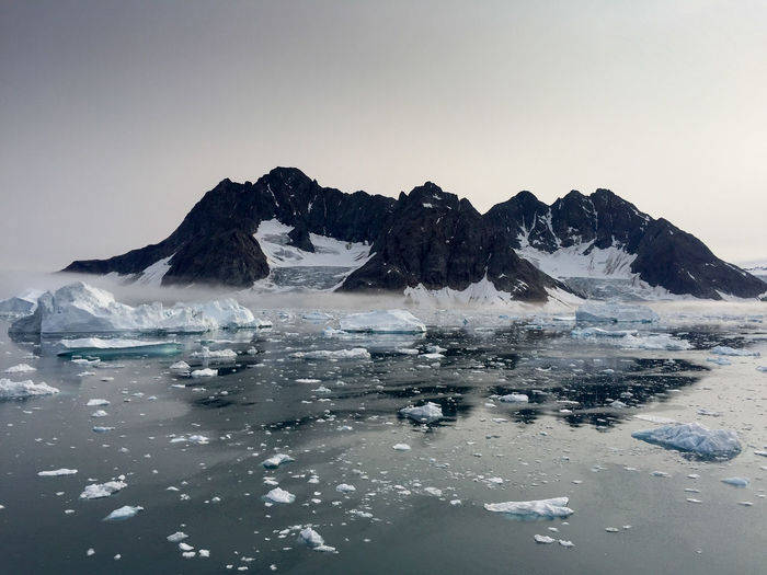 Drifting ice from the Greenland Glacier Beauty In Nature Cold Temperature Day Environment Floating On Water Frozen Glacier Ice Iceberg Landscape Melting Nature No People Outdoors Polar Climate Reflection Scenics Sky Snow Still Tranquil Scene Tranquility Water