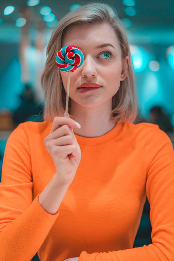 Close-up of woman holding lollipop
