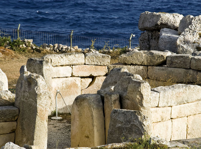Mnajdra Megalithic Temple Mnajdra Mnajdra Temple, Malta Ancient Ruins Approx. 3000 BC Ancient Architecture Built Structure Day Groyne Horizon Over Water Megalith Megalithic Megalithic Structure Nature No People Old Ruin Outdoors Sea Water