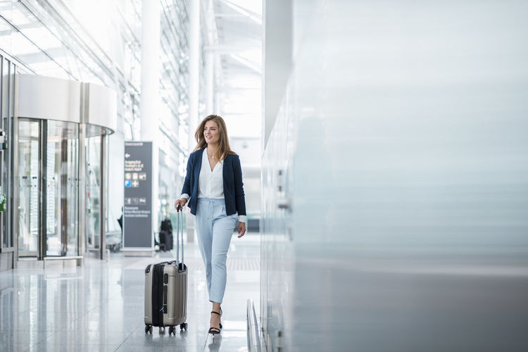 Full length of woman standing at airport