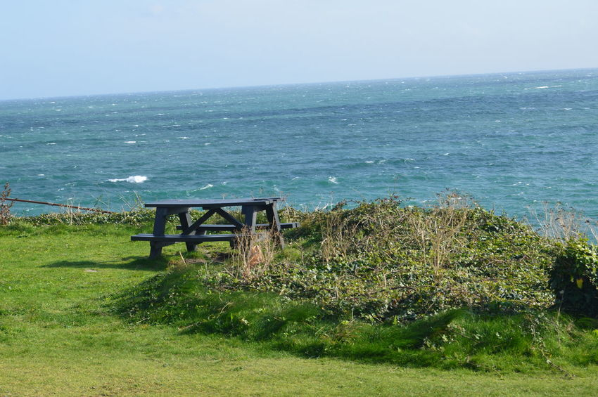 Bench Beauty In Nature Clear Sky Cornwall Cornwall Uk Day Grass Green Color Horizon Horizon Over Water Nature No People Outdoors Picknickbench Scenics Sea Sky Tranquil Scene Tranquility Water