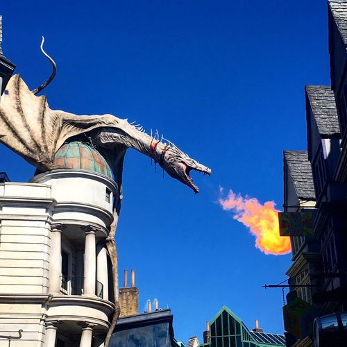 Building Exterior Built Structure Blue Architecture Clear Sky Low Angle View House Day Outdoors Sky No People City Residential Building Harrypotter Gringotts Dragon
