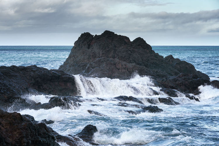 Seascape with waves crashing on the rocks in Seixal, Madeira Madeira Seixal Portugal Landscape Nature Seascape Ocean Atlantic Sea Rocks Travel Outdoors Panorama Panoramic View Rock Waves Coast Coastline Water Crashing Beach Geology No People Scenics