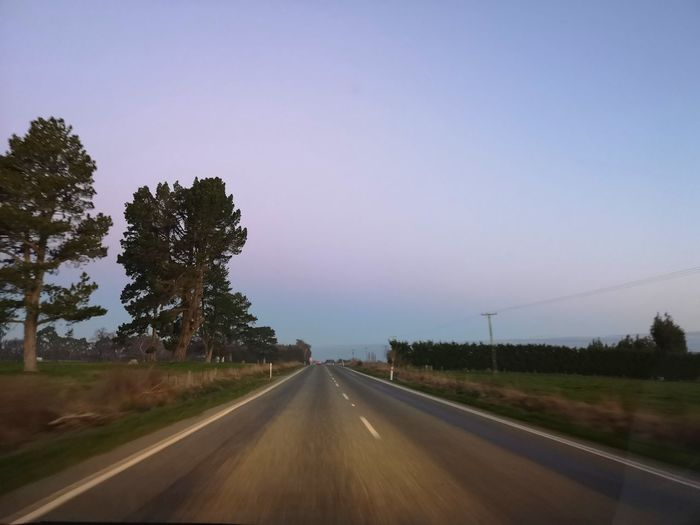Dusk on SH94 between Lumsden and Gore. Tree Rural Scene Road Point Of View Tree Area Remote Highway Diminishing Perspective Two Lane Highway Empty Road Country Road Car Point Of View