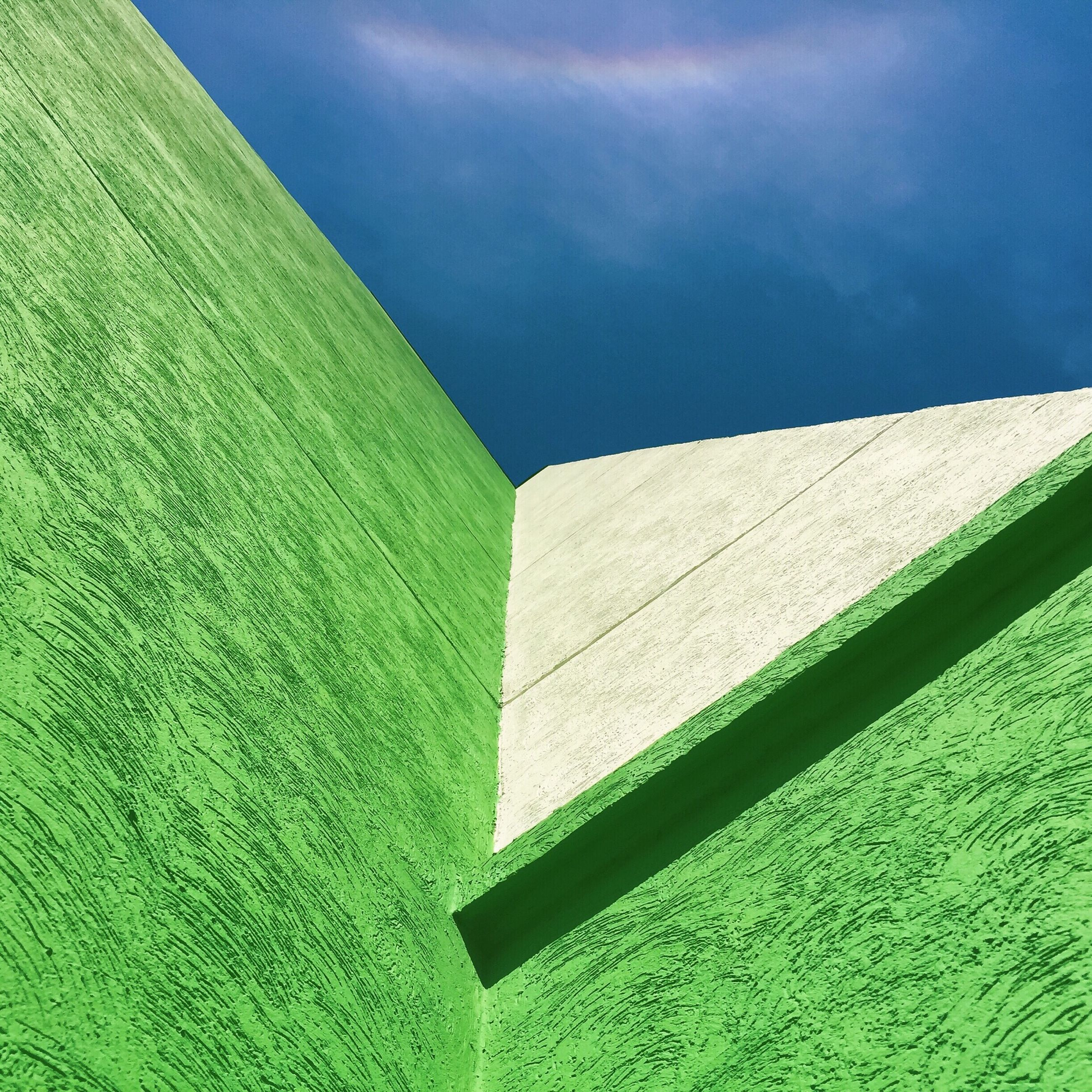 built structure, architecture, green color, blue, building exterior, sky, day, outdoors, pattern, green, no people, nature, water, low angle view, sunlight, close-up, cloud, wall - building feature, growth, part of