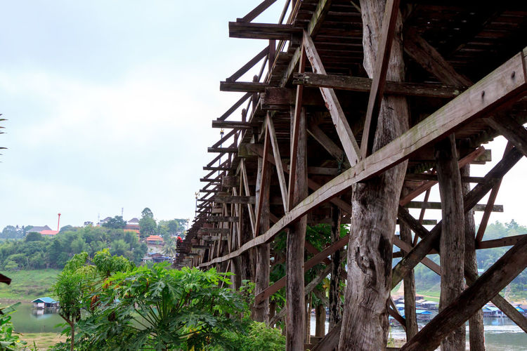 The Morn Bridge in Sangkhla Buri Architecture Footbridge Tranquility Travel Wooden Bridge Beauty In Nature Bridge Bridge - Man Made Structure Building Exterior Built Structure Day Mountain Mountain Range No People Outdoors River Sky Water Wood - Material