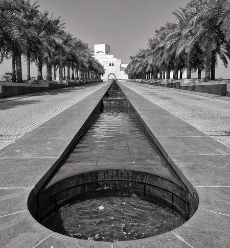 Museum of Islamic Arts (MIA) Grand Entrance Waterbody Waterfountain Flow Of Water Welcoming Positivevibrations Museum Museum Of Islamic - Qatar Museum Of Islamic Art Bwlandscape Bwphotography Simple Architecture Landscape Qatar The Way Forward Tree Outdoors Day Sky The Graphic City
