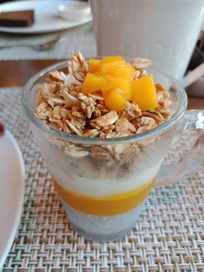 mango truffle EyeEm Selects Drink Fruit Breakfast Drinking Glass Table Granola Close-up Food And Drink Dried Fruit Raisin Cashew My Best Travel Photo
