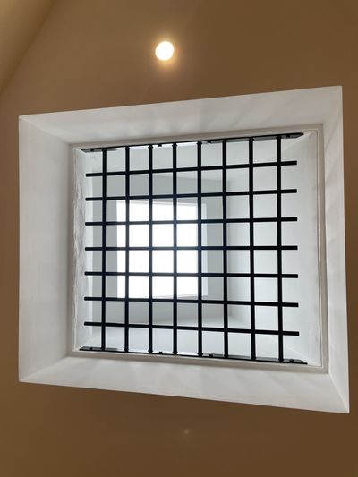Directly below shot of illuminated window in building