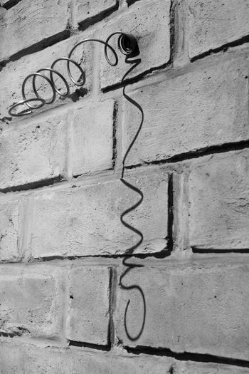 Architecture Black And White Building Exterior Built Structure Close-up Communication Day Graffiti No People Outdoors Pattern Shadows Spiral Spiral From Wall