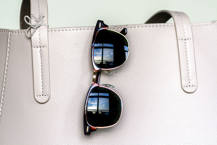 Close-up of sunglasses on mirror