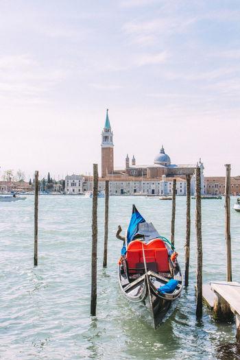 Gondola in grand canal against church of san giorgio maggiore