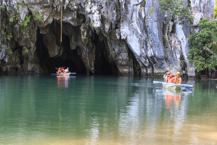 Puerto Princesa, Philippines - January 11, 2015: Visitors enter the Subterranean River in Puerto Princessa.The Underground River is one of the New 7 Wonders of Nature. ASIA Beach Beauty In Nature Corong Corong El Nido Nacpan Nature Nautical Vessel Palawan Philippines Puerto Princesa Reflection Rock - Object Rock Formation Scenics South East Asia Summer Tranquil Scene Tranquility Transportation Tree Tropics Underground River Water Waterfront
