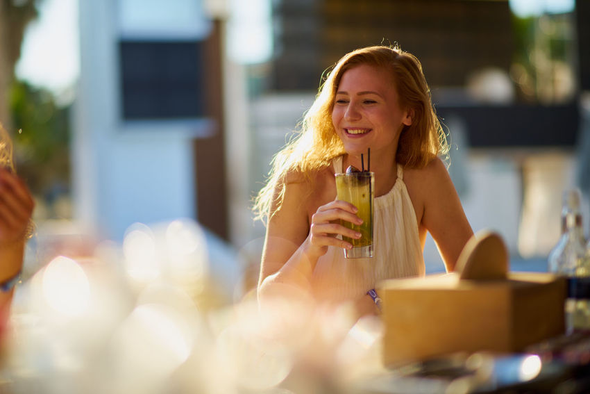 Adult Alcohol City Close-up Day Drink Drinking Drinking Glass Drinking Straw Food And Drink Freshness Happiness Holding Leisure Activity One Person Outdoors People Real People Refreshment Selective Focus Sitting Smiling Wineglass Women Young Adult