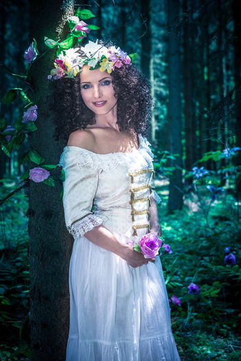 an outdoor portrait of a young wonan in the fairytale style Art, Attractive, Beautiful, Beauty, Costume, Creative, Dress, Elf, Enchanted, Fairy, Fairytale, Fantasy, Fashion, Female, Folklore, Forest, Girl, Girls, Goddess, Indigenous, Magic, Magical, Myth, Mythology, Nature, Nymph, Outdoors, People, Person, Rainfor Tree One Person Plant Standing Nature Hairstyle Outdoors
