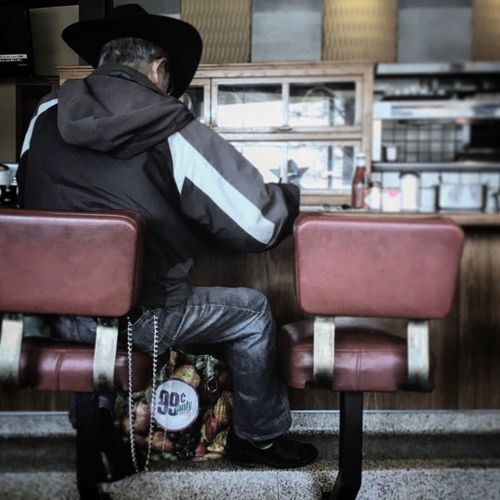 Sitting Chair One Person Social Issues People Adults Only One Man Only Outdoors Day Adult Artistic Photo Leisure Activity Ross Farrell Art Ross Farrell Photography Ross Farrell Design Real People Full Length diner cowboy hat