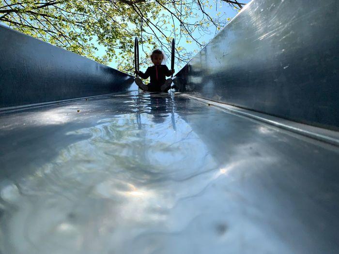 Silhouette girl on slide