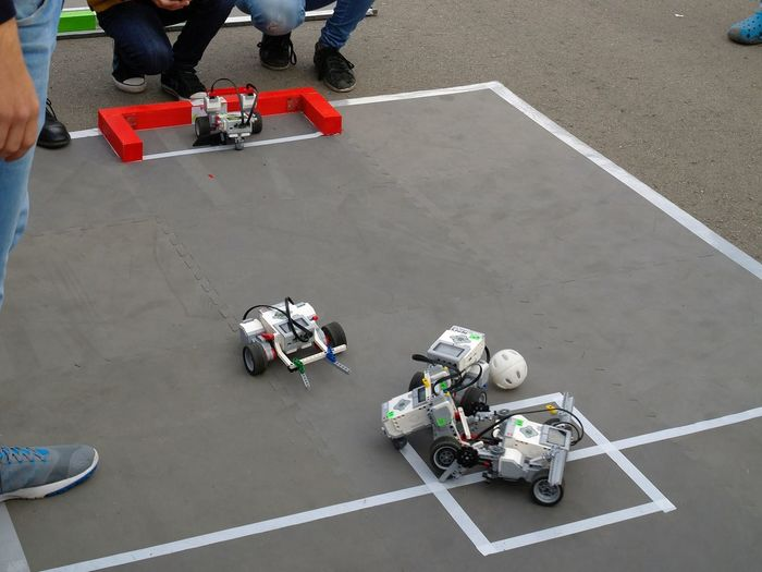 Robotics_football Football Goal Gaming Time Robots Competition Day Football Gate Game Goalkeeper High Angle View Low Section Men Outdoors People Real People Robotics Robotics_club Roboticscompetition Soccer Soccer Field Soccer Player Sport Transportation