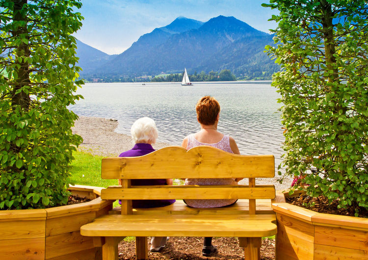 View on lake Schliersee, Bavaria, Germany Bavaria Bench Schliersee Vacations View Age Destination Germany Lake Leisure Lifestyles Mountain Nature Old Outdoors Pension People Rear View Relax Relaxation Rest Retirement Sitting Water Women