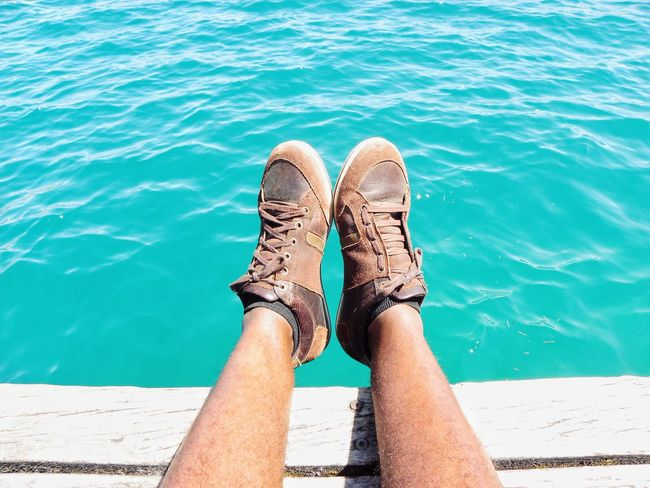 Human Body Part Low Section Water Beach Human Leg Personal Perspective Vacations Sea Summer Outdoors Day Leisure Activity Lifestyles Relaxation Pier Sitting On Pier Blue Colour Blue Sea Blue Water Tropical Climate Tropical Nature Lake Garda Enjoying Life Chilling