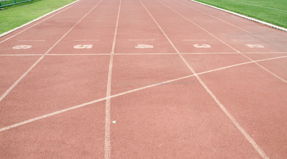 Track roll in the stadium. Treadmill Stadium Track And Field Treadmill Absence Competition Competitive Sport Day Diminishing Perspective Direction Dividing Line In A Row Nature No People Number Outdoors Running Track Sport Sports Track The Way Forward Track Track And Field Track And Field Event