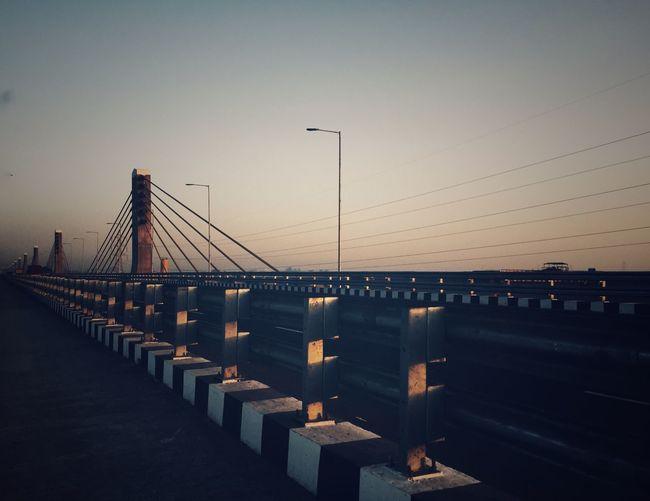 Suspension Bridge Against Sky During Sunset
