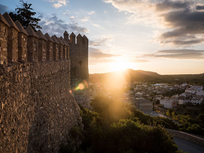 Castle against sky during sunset
