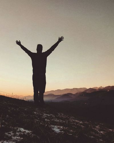 Silhouette One Man Only Arms Raised One Person Arms Outstretched Standing Landscape Sunset Outdoors Sky Sunlight Shadows Nature Freedom Dramatic Landscape Shadows & Lights EyeEm Best Shots EyeEmNewHere EyeEmBestPics Lifestyles Feelings Winner Happiness View Peaceful