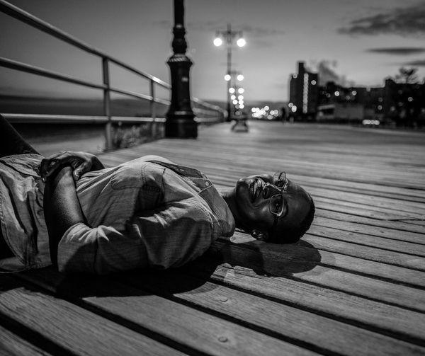 Woman Relaxing On Pier