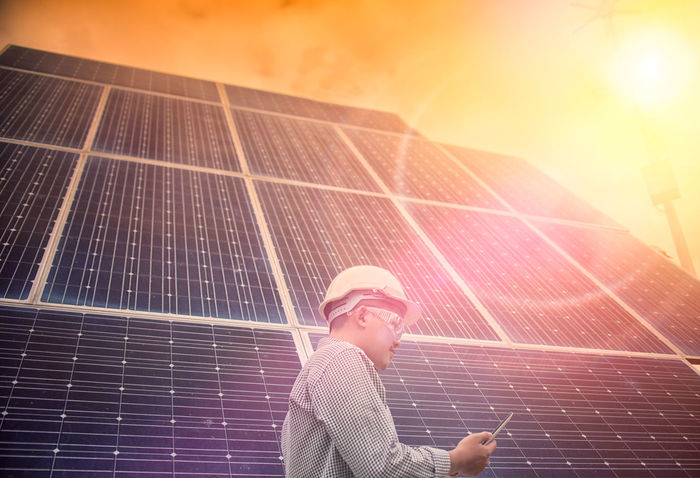 Adult Alternative Energy Electricity  Environment Environmental Conservation Environmental Issues Fuel And Power Generation Lens Flare Nature One Person Outdoors Portrait Power Supply Renewable Energy Sky Solar Energy Solar Panel Sun Sunlight Sustainable Lifestyle Sustainable Resources Technology