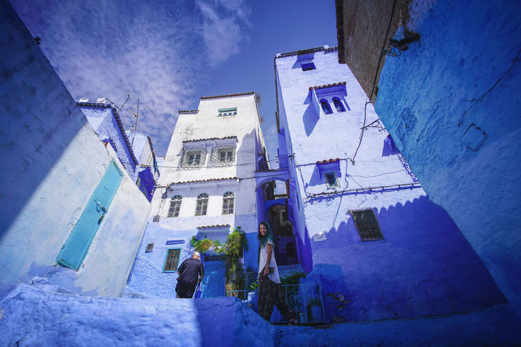 """The Blue City"" - Chefchaouen, Morocco. Chefchaouen Chefchaouen Medina Medina Morocco MoroccoTrip EyeEmNewHere a new beginning Digital Nomad Travel Travel Destinations Traveling Travel Photography Photography Blue City Alley Maze Arabic Moroccans Tourism Tourist Attraction  Tourist Destination Building Exterior Architecture Built Structure Building One Person Men Standing Day Nature Adult Real People Rear View Sky Walking Outdoors Low Angle View Women Residential District"