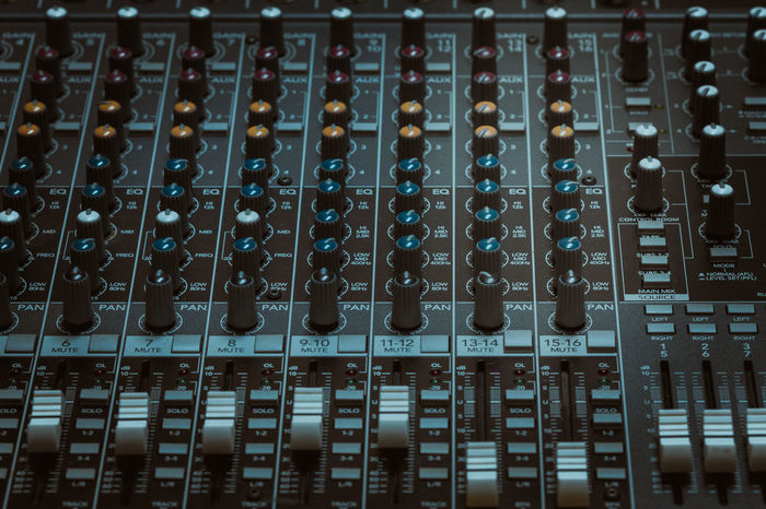 Buttons and tabs in various parts of the audio controller mixer ,music,mixer in studio,audio sound mixer with buttons and sliders Audio Mixer Audio Studio Audio Technica Buttons And Buttons Mixer Desk Music Sliders TAB Various