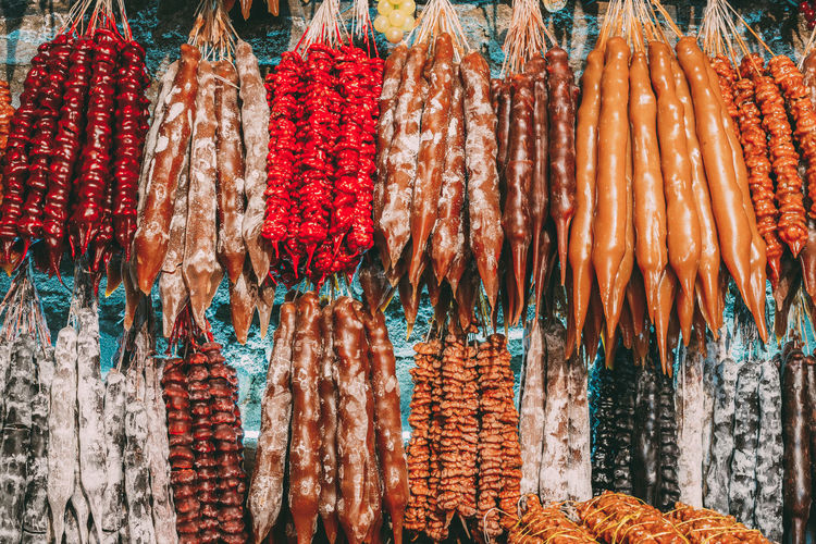 Various fruits hanging for sale at market stall