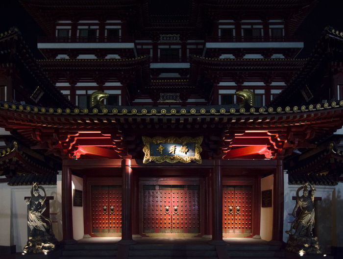 The Buddha Tooth Relic Temple of Chine town, Singapore at night. Singapore Architectural Column Architecture Belief Buddhist Temple Building Building Exterior Built Structure Entrance Illuminated Lighting Equipment Low Angle View Night No People Ornate Outdoors Place Of Worship Religion Spirituality Temple