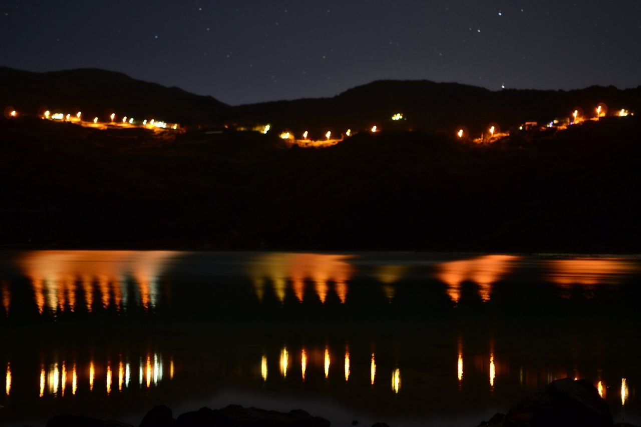night, reflection, nature, water, beauty in nature, no people, tranquility, scenics, lake, outdoors, mountain, illuminated, sky