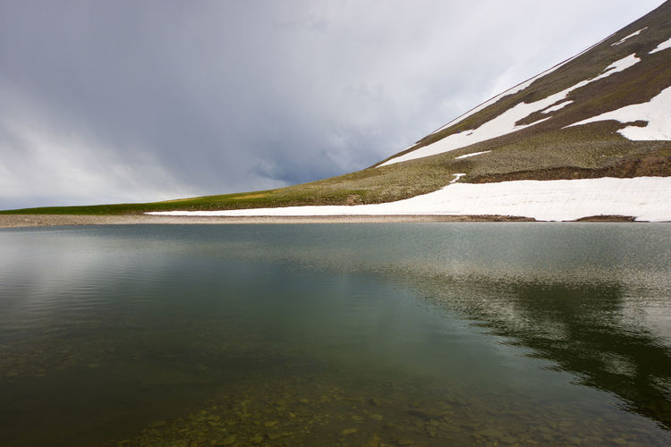 Alpine mountain lake landscape and view, snow and clouds in javakheti, georgia