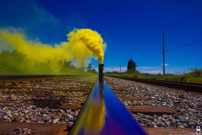 BePositive👍👍 Homelessman firesmoke First Eyeem Photo Taking Photos Vancityhype Neverstopexploring  Check This Out Yellow Colour Train Tracks Trainphotography blue smokebomb