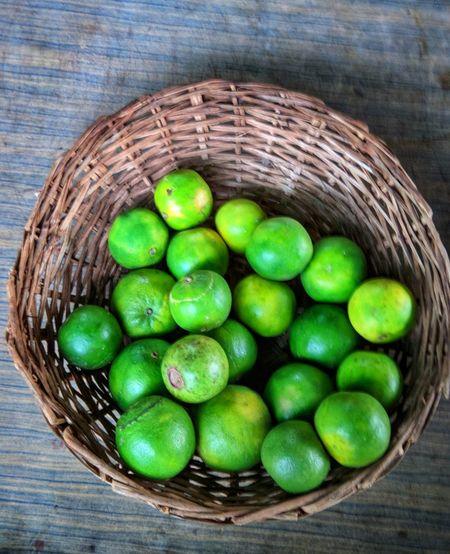 Basket full of Mossambi's and Guva Food Organic Fruits Farmfresh Mosambi Guva Fruit Basket High Angle View Wood - Material Green Color Food And Drink