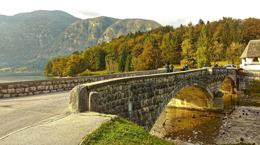 Scenic view of bridge over river against mountains