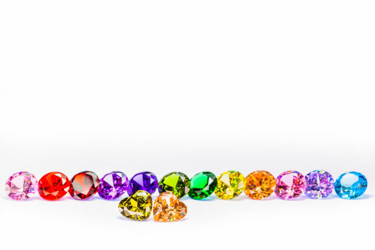 colorful diamonds in white background with copy space Rice Choice Colorfull Copy Space Diamond, Gem Gemstone  Multi Colored No People Still Life Studio Shot Variation