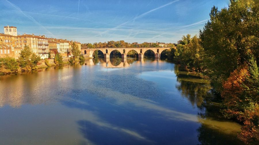Bridge - Man Made Structure Built Structure Tree Sky River No People Travel Destinations Nature City Outdoors Reflection Architecture Day Arch Water France Occitanie River