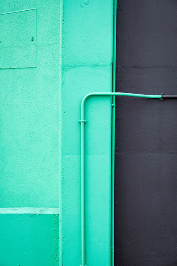 Close-up of blue pipes against wall