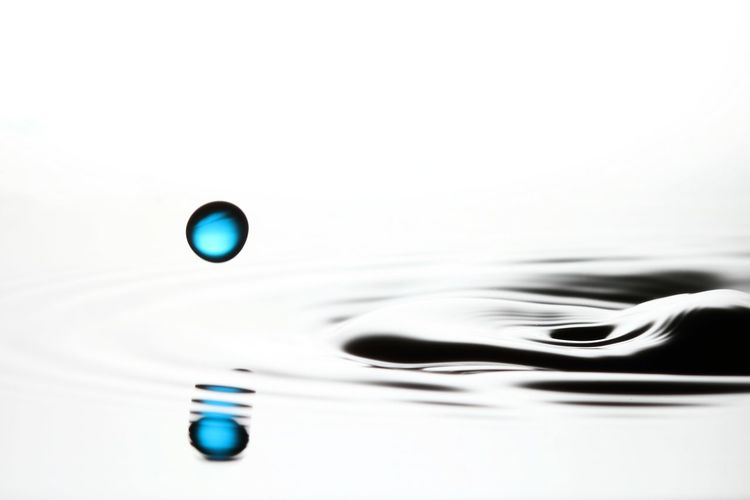 Close-up of drop falling on water surface