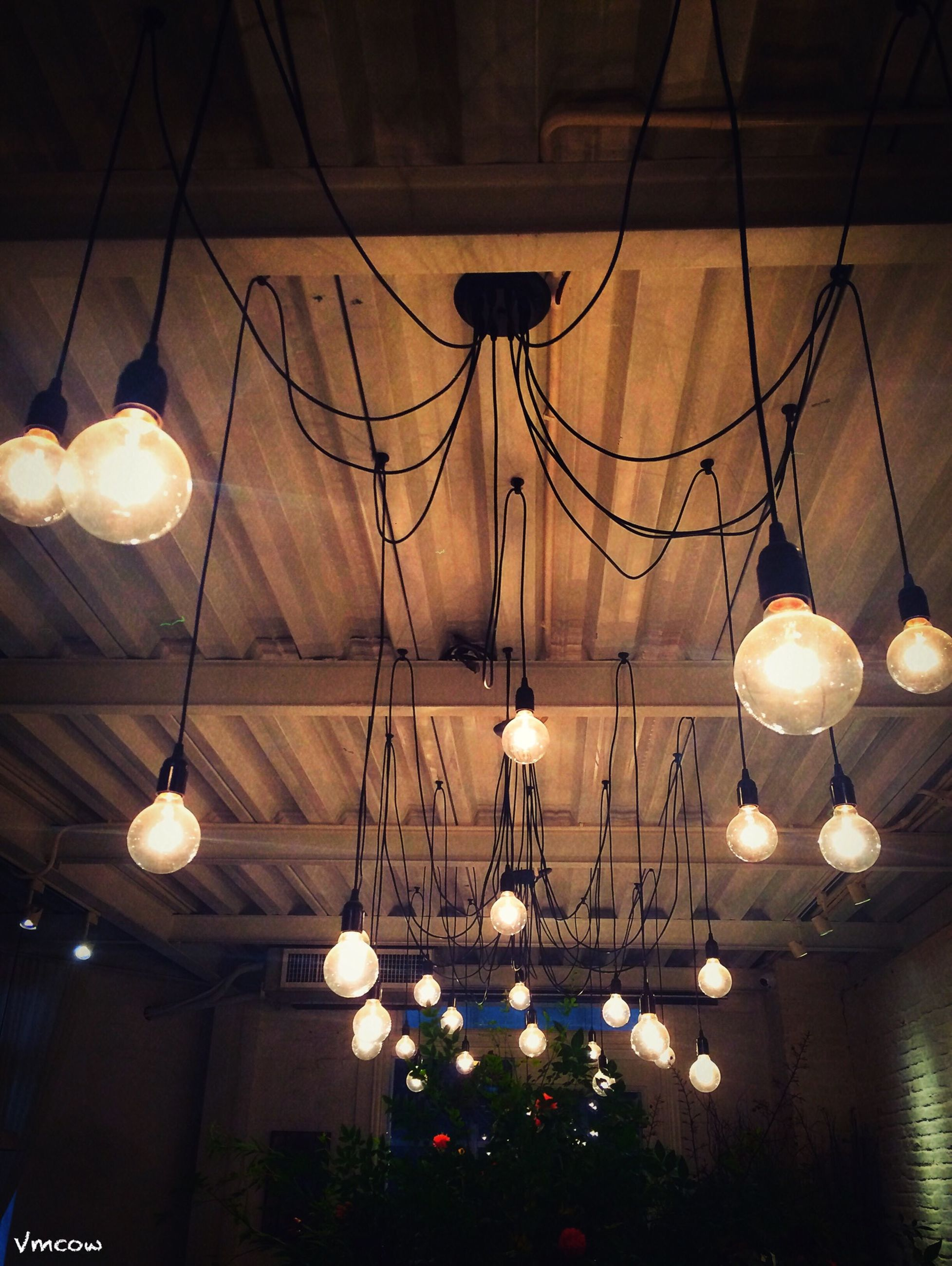 illuminated, indoors, lighting equipment, ceiling, hanging, electric lamp, electricity, decoration, electric light, chandelier, low angle view, light bulb, home interior, light - natural phenomenon, night, decor, lamp, glowing, lit, hanging light