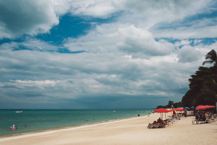 Thailand Sea Sky Cloud - Sky Beach Water Land Sand Horizon Over Water Scenics - Nature Horizon Beauty In Nature Nature Day Incidental People Tranquility Group Of People Outdoors Holiday Tranquil Scene